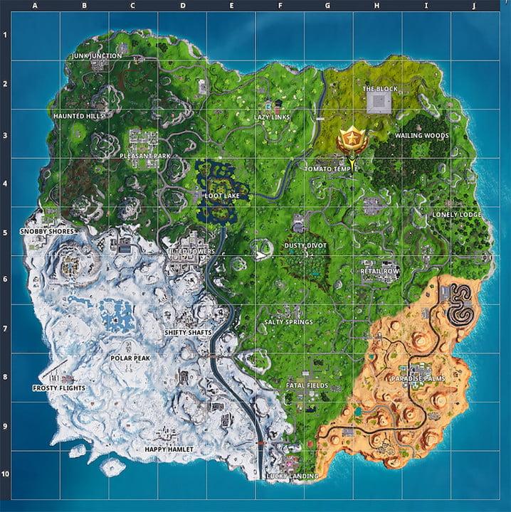 localisation de l'étoile de combat sur la carte   fortnite saison 7 semaine 5 défis recherche entre un rocher géant homme couronné tomate et arbre encerclé