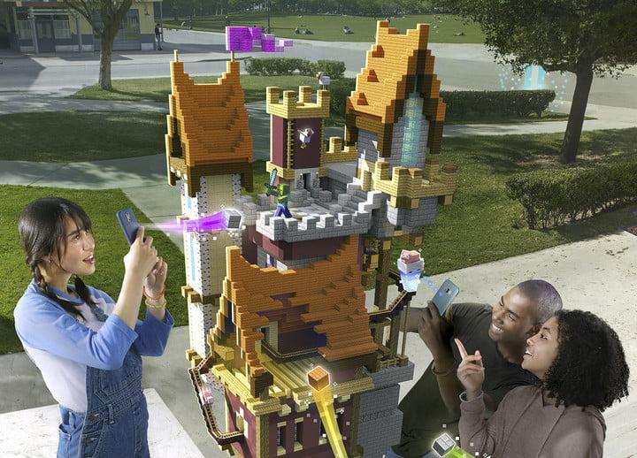 Des joueurs construisent une structure de château ensemble dans un parc| Minecraft Earth Key Art